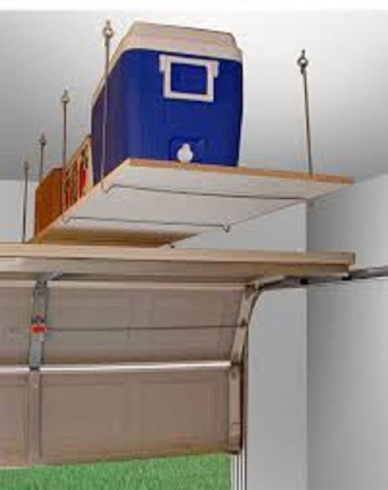 creative simple floating diy shelving unit above garage door to hold functional boxes with lots. Black Bedroom Furniture Sets. Home Design Ideas
