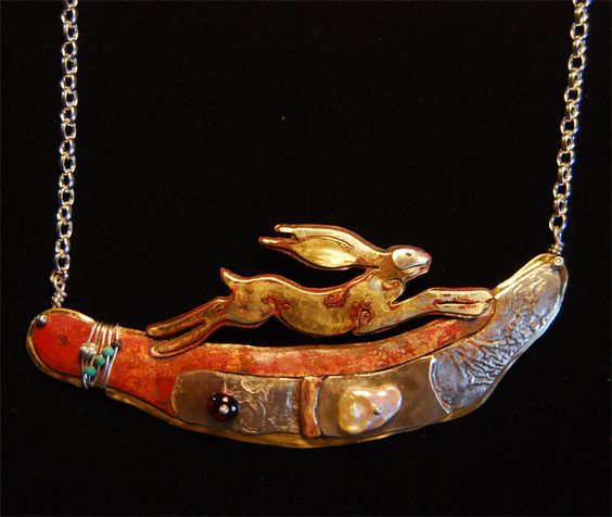 necklace designed by Sara Lloyd Morris, of a hare running over an ancient landscape