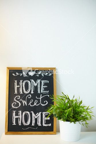 Photo Of Small Board With Message About Home