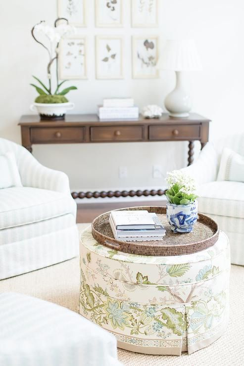Round Skirted Ottoman Upholstered With White And Green Floral
