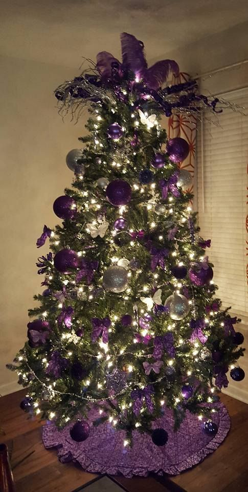 Violet Christmas tree... Love the feather topper and the ruffled ...