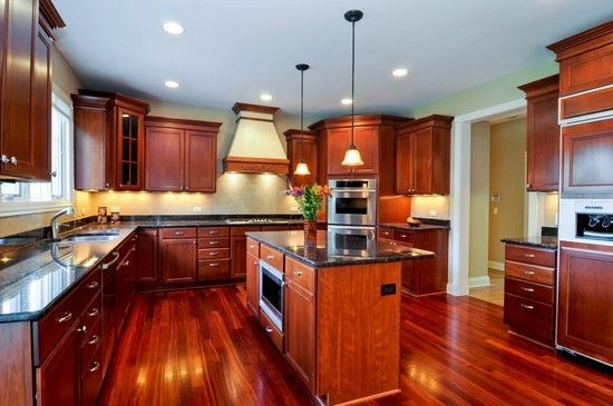 Amazing kitchens with cherry hardwood floors kitchen for Acorn kitchen cabinets