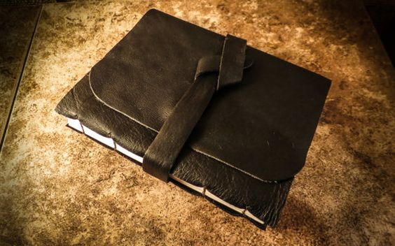Rustic raw edged hand stitched leather book using por CascadianArt