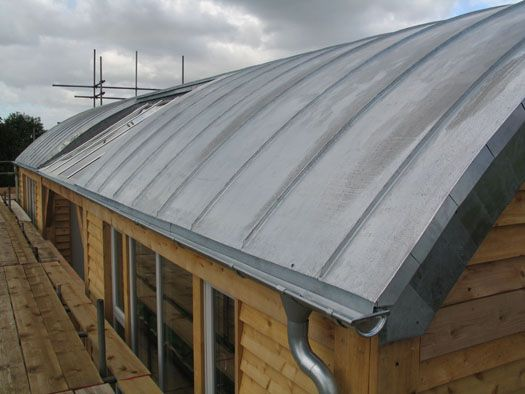 Curved Zinc Roof With Galvanised Guttering And Larch