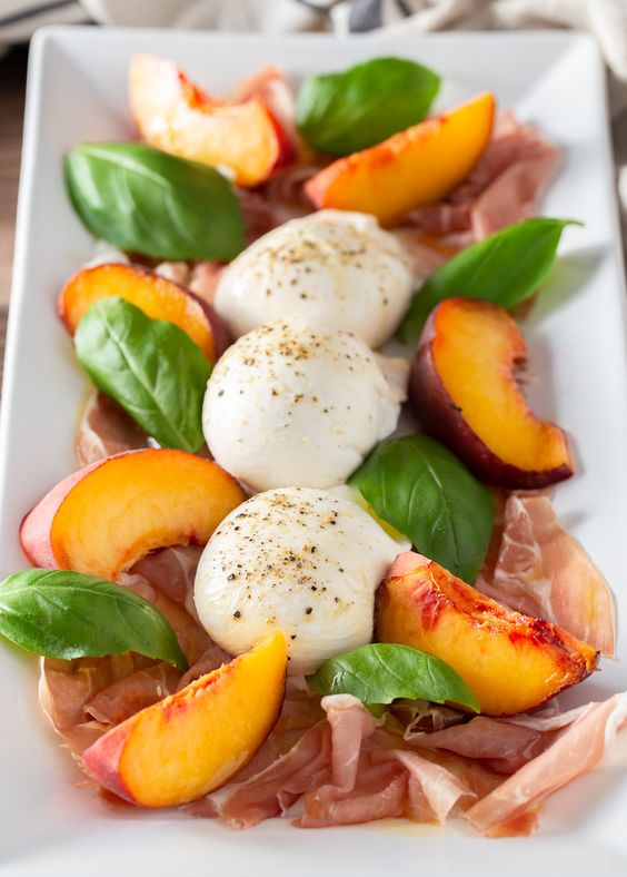 Peaches with Burrata, Basil, and Prosciutto