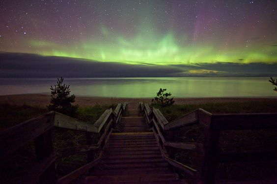 Northern lights above water