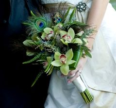 love the idea of peacock feathers in a wedding bouquet, but maybe with some other type of flower...