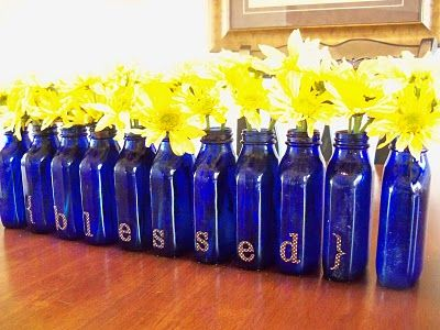 """This cute """"Blessed"""" centerpiece is made from old Milk of Magnesia bottles! It really says SPRING!"""