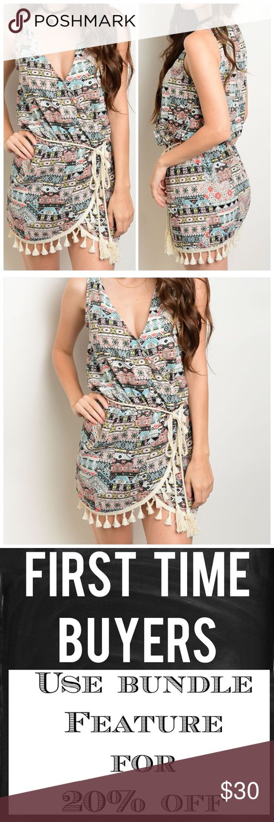 """Multicolred wrap tassel trim dress Perfect cool and casual dress. Multicolored all over print. Surplus wrap front. Tie waist with tassel trim and hem. Rock this look anywhere this summer!! Made in the USA. 100% polyester. Approximately 33"""" long. CupofTea Dresses Mini"""