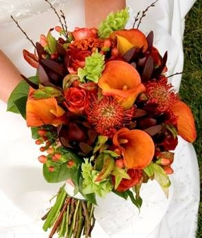 Orange mini callas, safari sunset, belles of ireland, coffee berries, orange roses, orange  pin cushion proteas