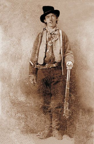 This is the only indisputable photo of Billy the Kid (1859 – 1881). Billy the Kid also known by the aliases Henry Antrim and William H. Bonney was a 19th-C American frontier outlaw. He was relatively unknown during his own lifetime but became a legend a year after his death when his killer, Sheriff Garrett published a biography titled The Authentic Life of Billy the Kid. According to legend Billy killed 21 men, one for each year of his life but he most likely killed fewer than half that number.