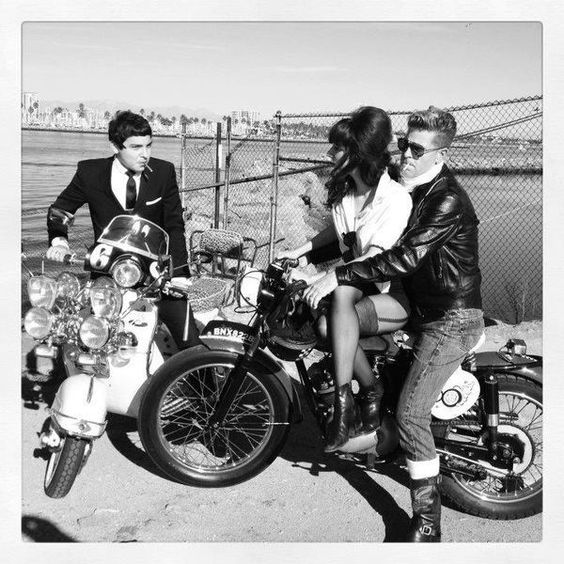Mods and Rockers. Portrayed as major enemies by the media, but were more often mates! My parents were rockers and they had mod friends. They all used to hang out and swap motorcycles and scooters with one another!