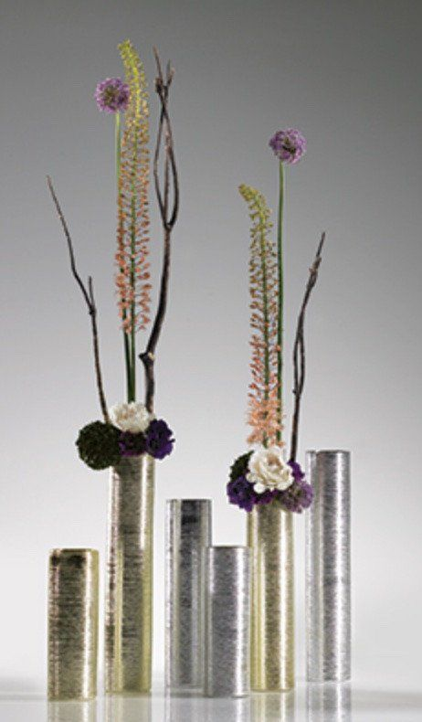 "Gorgeous Zodiac ceramic cylinder vase in gold. Use a mix of silk flowers, tall stems, greenery, and more to create a tall and elegant main centerpiece for your glam or modern weddings! - 16"" Tall - 4"""
