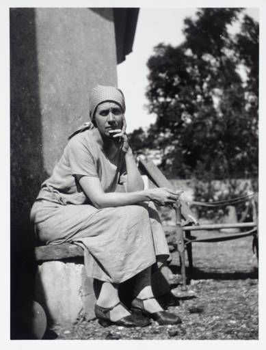 thebloomsburygroup:    Vanessa Bell sitting outside the drawing room in the garden of Charleston, the home she shared with Duncan Grant.