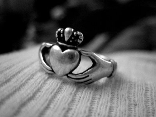 The Claddagh ring... an irish symbol. I'd be cool to get this as a tattoo.