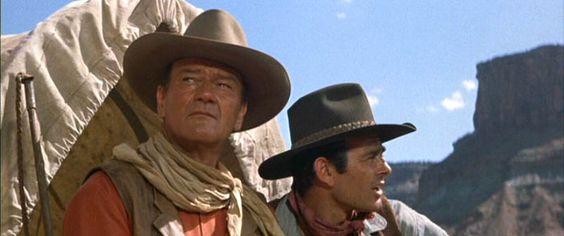 "Duke and Stuart Whitman are on the lookout for Comanches in ""The Comancheros"" (1961).:"