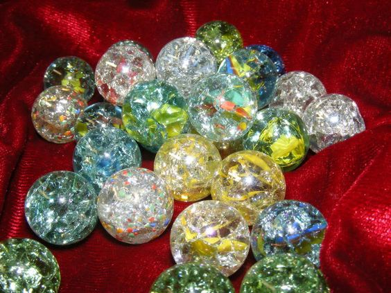 Heat clear marbles in oven at 500 degrees for 20mins. Then put in ice water.