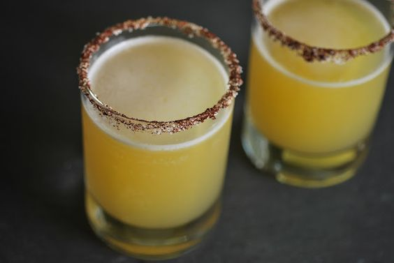 Pineapple Margaritas with a chili powder, salt rim and agave nectar.