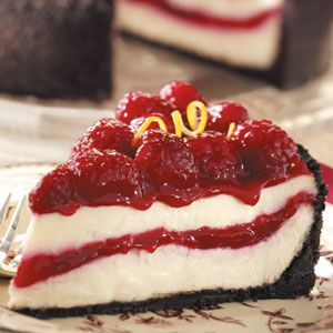 Raspberry Ribbon Cheesecake Recipe -Here's a mouthwatering dessert that's sure to impress family and friends. Not only does it taste wonderful with its chocolate cookie crust, rich creamy cheesecake and tangy raspberry center and topping...it also looks lovely!—Peggy Frazier, Indianapolis, Indiana