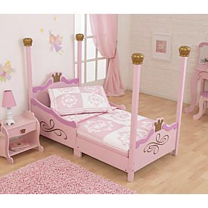 KidKraft Princess Toddler Bed: Once she sees this magnificent princess toddler bed, she'll never look back at the crib! This pink poster bed will be the centerpiece of her bedroom, with four regal posts, an elaborate headboard and footboard, and tall side rails to keep her safely inside. She'll love the metallic gold detail and royal crown accents. Low to the floor for easy in and out...