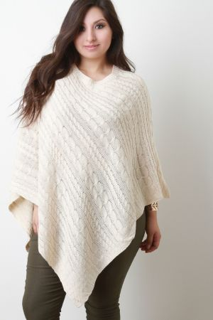 Cable Knit Asymmetrical Poncho. Description This plus size  poncho  features a cable knit throughout, a ribbed round neckline, and a pointed asymmetrical hemline. Accessories sold separately. 100% Acrylic.   Measurement   Size Bust Hem  Length  Sleeve    OS  20  40  38  22