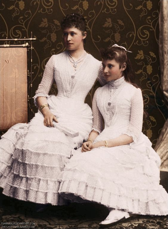 """Princesses Irene and Alix of Hesse (Darmstadt) and by Rhine dressed as bridesmaids on the occasion of their maternal aunt's wedding,Princess Beatrice to Prince Henry of Battenburg. (colourised) """"AL"""""""