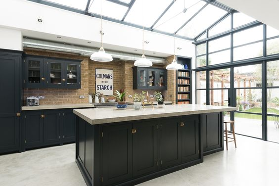 We love the beautiful pieces of antique furniture and superb concrete worktop and flooring in deVOL's Balham Kitchen.