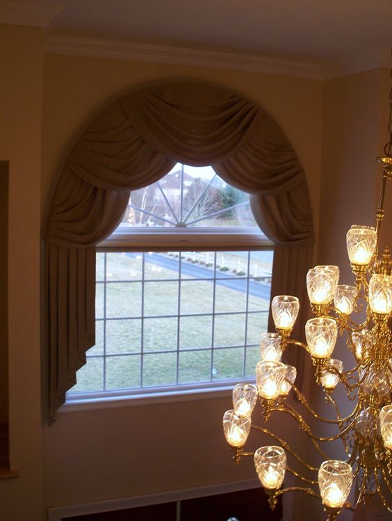 Overlapping swags over an arch window