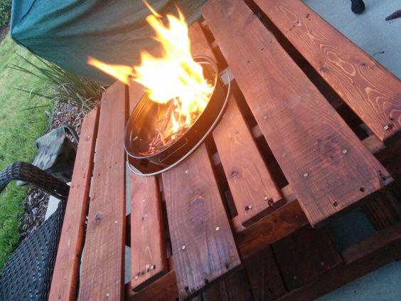 Pallet table with firepit/grill. This was our take on the project.