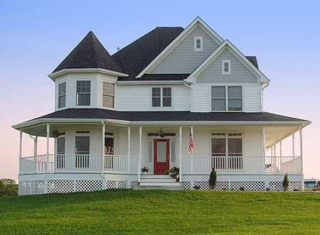 I love this wrap around porch and the turret!