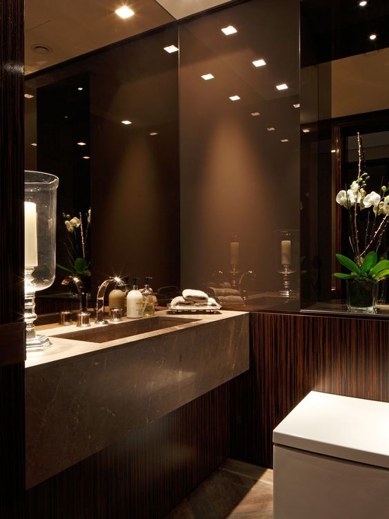 Brown lacquer bathroom with trough sink, brown walls, wenge wood Brown and bronze