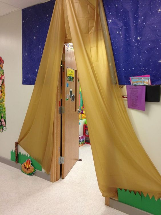Camping Theme- Did this for my classroom door. Used table cloths from dollar tree.: