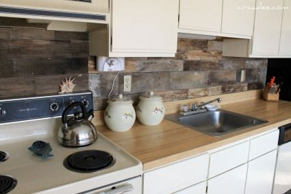 reclaimed wood kitchen backsplash. Love it! Would like to consider this whenever we finally redo the kitchen, but will have to think how it would look paired with a reclaimed wood breakfast bar. I know it would look sick with marble or concrete countertops.