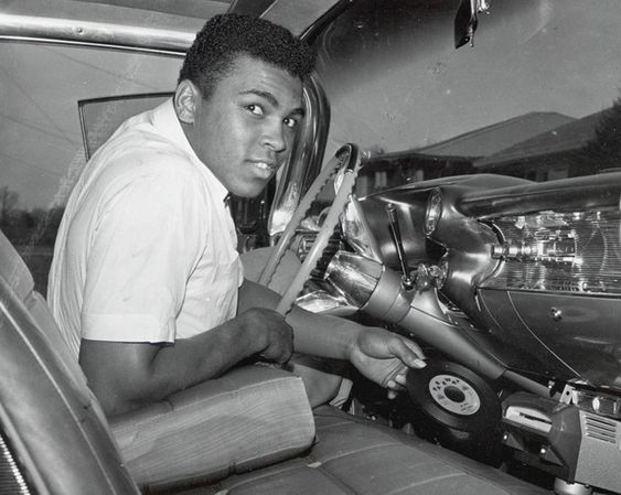 Cassius Clay in his 1960 Cadillac with a record player: