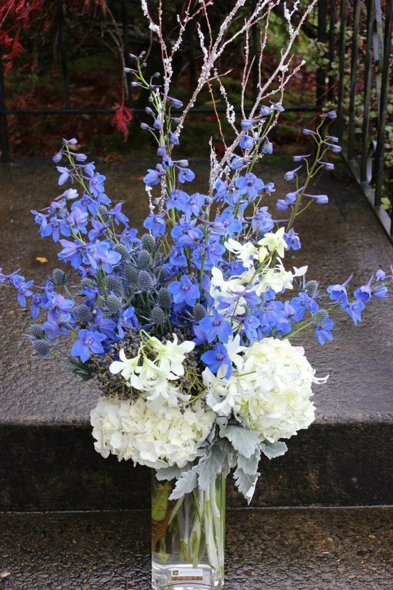 Blue white silver winter bouquet arrangement with winter for Floral arrangements with branches