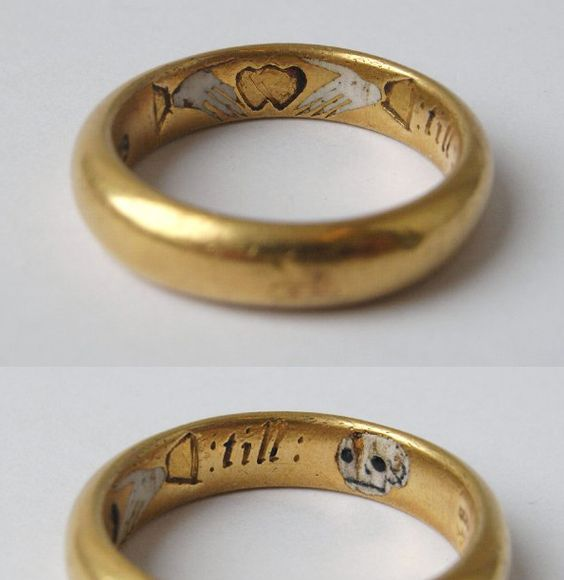 Posy ring with pictogram inscription, 'Two hands, one heart, Till death us part.' Remains of red and white enamel in inscription. Made in England in the 17th century