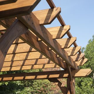 This cedar pergola is ideal for creating a backyard oasis. Made from solid wood, the pergola is strong and durable, and it arrives pre-stained and ready for assembly. The 10 x 12 pergola is the perfec                                                                                                                                                      More