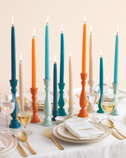 painted candlestick centerpieces. DIY . Runs around $8 a table with 3 candlesticks per table, but only using white, green and yellow with candles from ikea