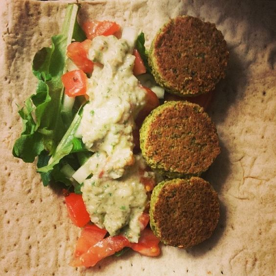 Falafel with homemade cucumber-dill sauce on a whole wheat lavash wrap ...