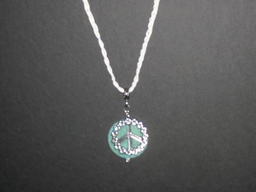 jade peace sign necklace