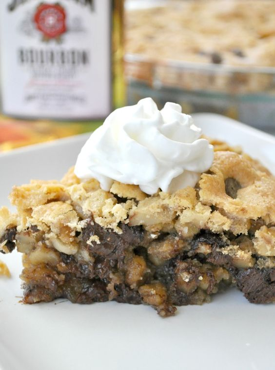 Derby Pie ~ A thick, gooey chocolate chip cookie meets a warm buttery pie for a heavenly and decadent Southern dessert!: