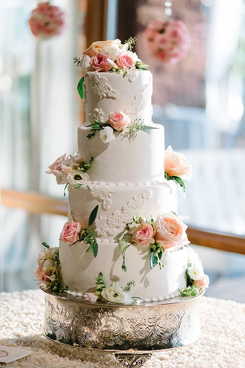 Wedding Cake with Fresh Roses and fondant lace appliques. Photo by Kate Holstein
