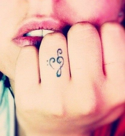 Music Tattoo . . . treble clef and bass clef form a heart
