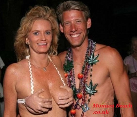 Do you really just want people to laugh at your breasts??  I think HE made her wear that!  Eeww.:
