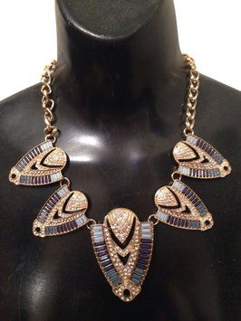 Crystal Egyptian Statement Necklace in Turquoise And Gold. Get the lowest price on Crystal Egyptian Statement Necklace in Turquoise And Gold and other fabulous designer clothing and accessories! Shop Tradesy now