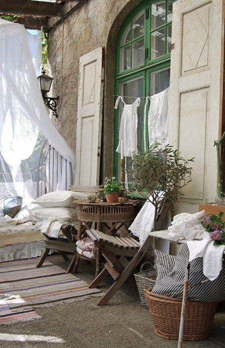 French country rustic. Love the shutters