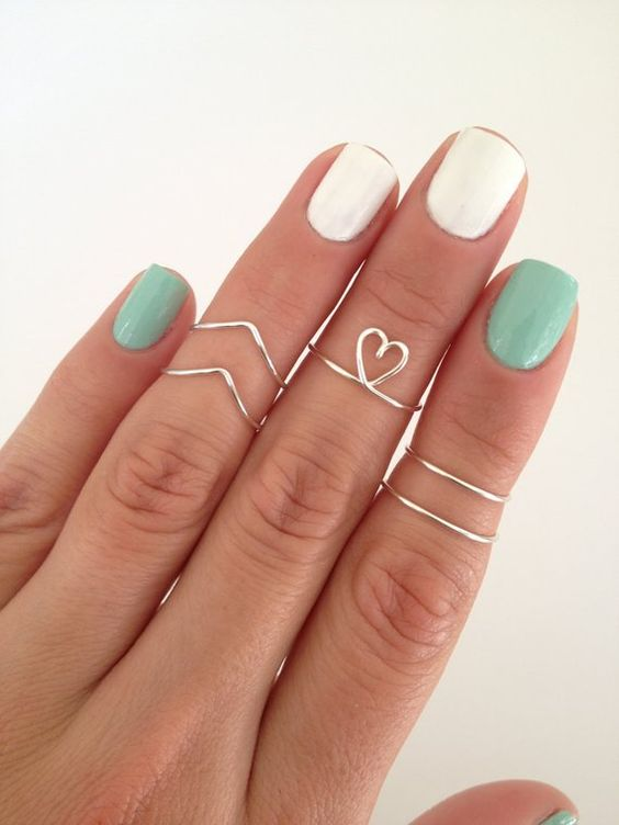 Pretty and dainty with a modern twist! They can be worn all together at the same time, or separate for a more subtle look. 5 adjustable rings for this listing -2 Chevron Midi Rings -1 Dainty Heart Midi -2 Simple Bands Each ring has looped ends on the back, so they are adjustable