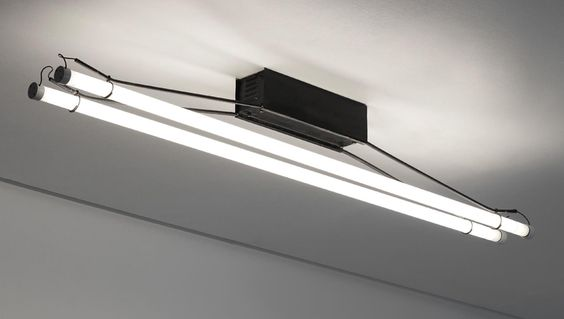 GINO SARFATTI Ceiling light, model no. 3026, circa 1954 Painted tubular steel, painted metal, two fluorescent bulbs. 9 1/4 x 70 1/4 x 6 1/2 in. (23.5 x 178.4 x 16.5 cm) Manufactured by Arteluce, Italy.