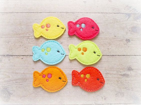 Fish felt applique are machine embroidered using wool blend felt. You will receive a orange, aqua, yellow, lime, tangerine and  watermelon. They
