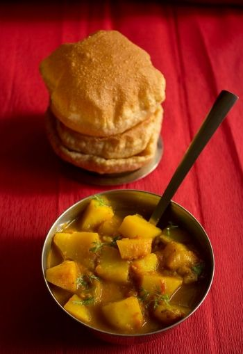 aloo poori (punjabi spiced potatoes) with carom powder